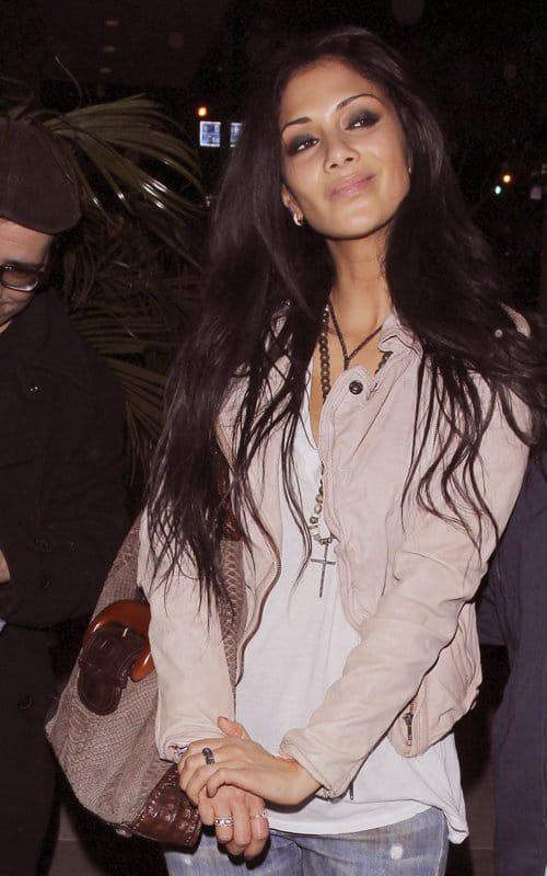 Singer and X-factor judge Nicole-Scherzinger wears Muubaa jacket
